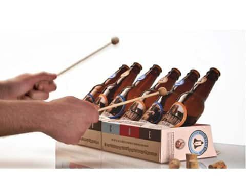 como elaborar un instrumento musical con botellas