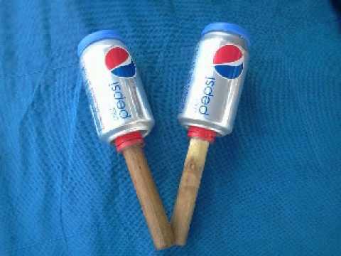 como hacer maracas con latas de refresco