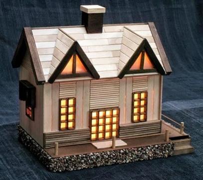 casas de palitos de paleta con luces