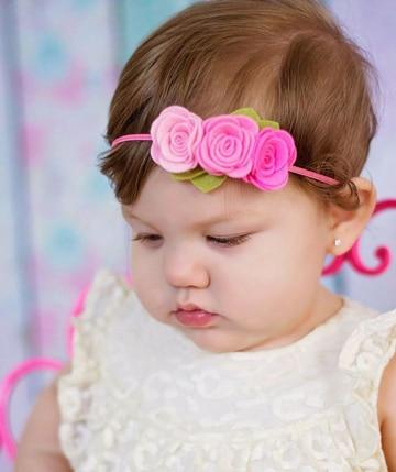 diademas de flores para bebes rosadas