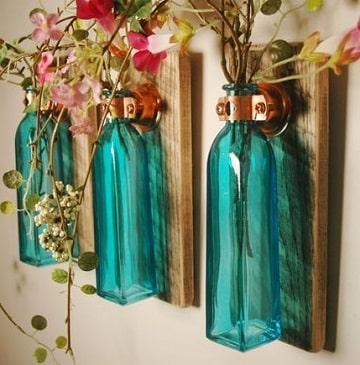 arreglos con botellas de vidrio florero