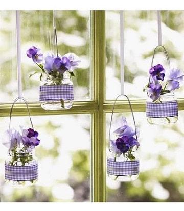 ideas con frascos de mermelada floreros colgantes
