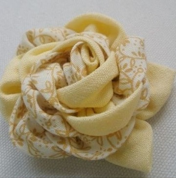 como hacer flores de tela para el cabello amarilla