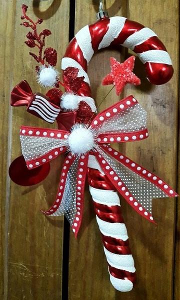 moños de navidad para puertas con baston