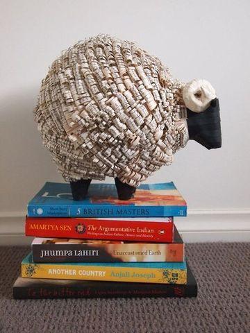 manualidades con periodico faciles tipo escultura