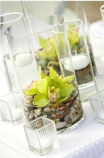 centros de mesa con piedras y orquideas