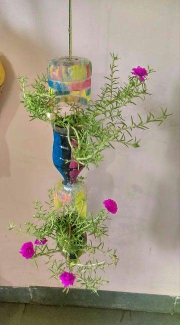 como hacer floreros reciclados de botellas de plastico