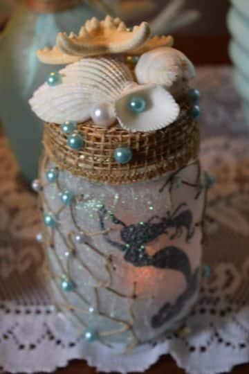 manualidades con frascos de vidrio y conchas de mar