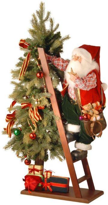 escaleras navideñas de madera con papa noel