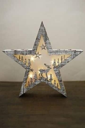 estrellas navideñas con luces y carton