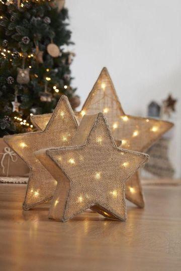 estrellas navideñas con luces y tela