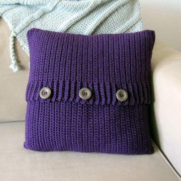 cojines decorados con botones tejidos