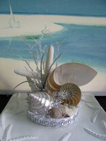 adornos con caracoles de mar centro de mesa