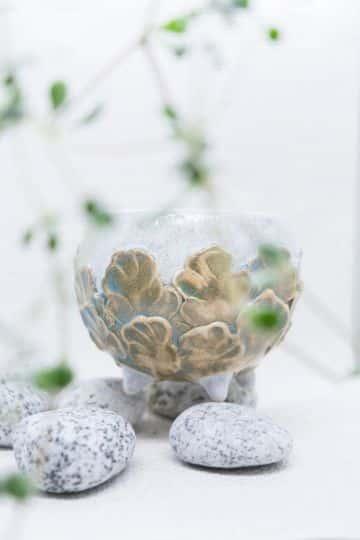 macetas decoradas con piedras para interiores