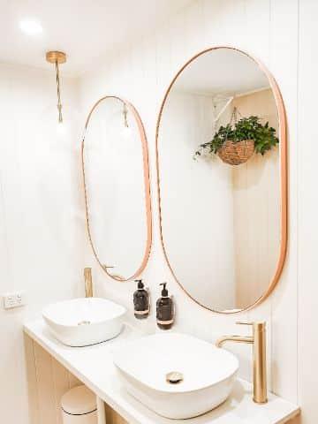espejos ovalados para baños de madera