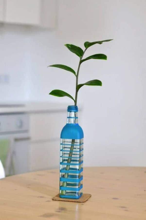 Floreros de botellas plasticas en casa